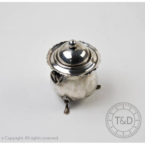 25 - A Victorian silver tobacco jar, Walker & Hall, Birmingham 1899, of cauldron form, with swing handles...
