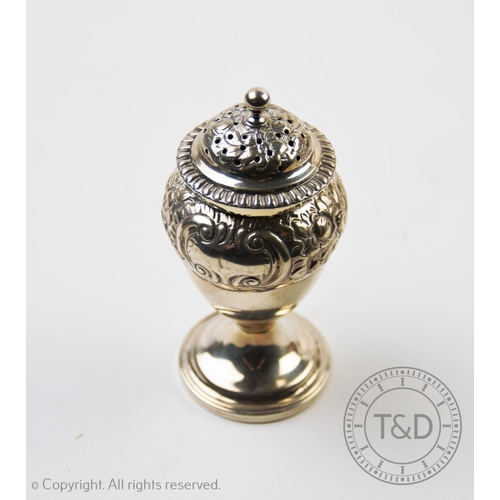 27 - A George IV sugar caster, Thomas Johnson I, London 1824, of baluster form, embossed with scrolling f...