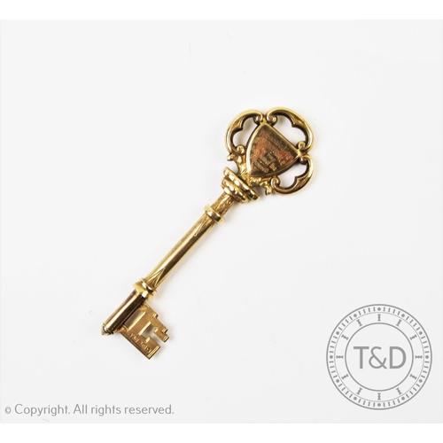 31 - LOCAL INTEREST: A silver gilt presentation key, Vaughton & Sons, Birmingham 1920, with scroll form d...