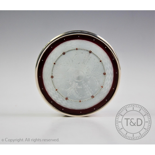 9 - A late 19th century continental white metal and guilloche enamel box, of circular form decorated wit...