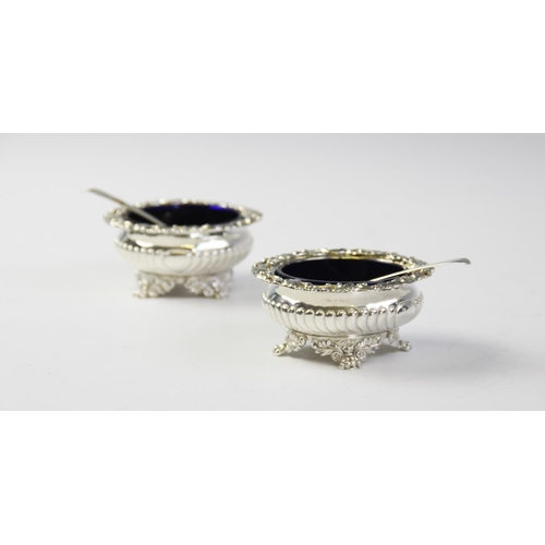1 - A pair of George IV silver salts by Solomon Royes, London 1820, each of circular squat form with orn...