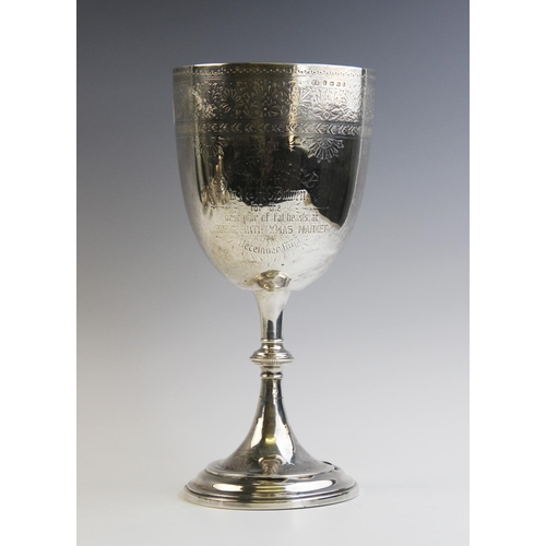 12 - A large Victorian silver trophy cup by Elkington & Co, Birmingham 1885, of tapering form on knopped ...