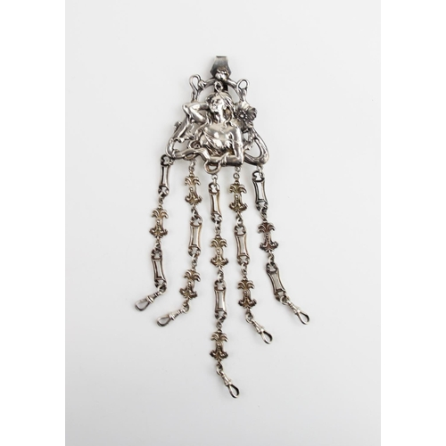 20 - An Art Nouveau silver chatelaine by George Unite, Birmingham 1901, the mount designed as a maiden wi...