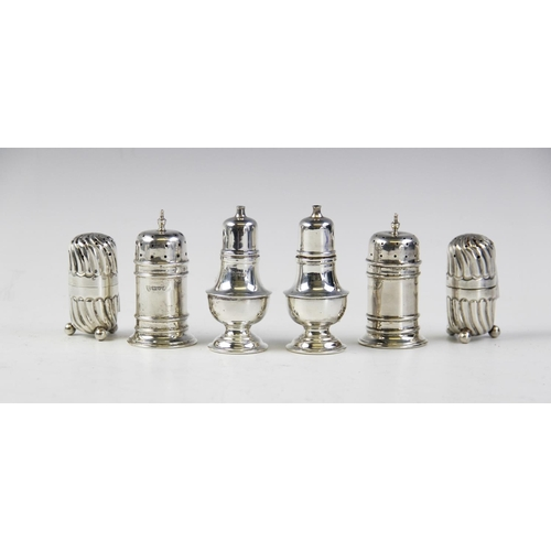 3 - A pair of silver pepperettes by Adie Brothers, Birmingham 1936-37, of baluster form on stepped circu...