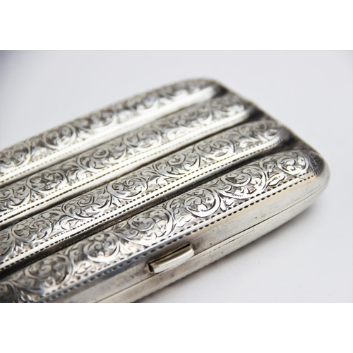 33 - A George V silver cigar case by John Rose, Birmingham 1913, of typical form with scrolling foliate d...