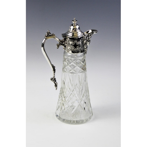 42 - An Edwardian silver mounted cut glass claret jug, Sheffield 1905, of tapering form with star cut bas...