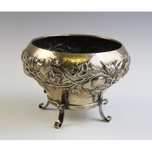 56 - An Arts & Crafts silver bowl by Elkington & Co, London 1901, of tapering baluster form on three scro...