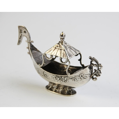 57 - An miniature silver model of a boat, import marks for George Bedingham, Chester 1906, 10.7cm long, w...