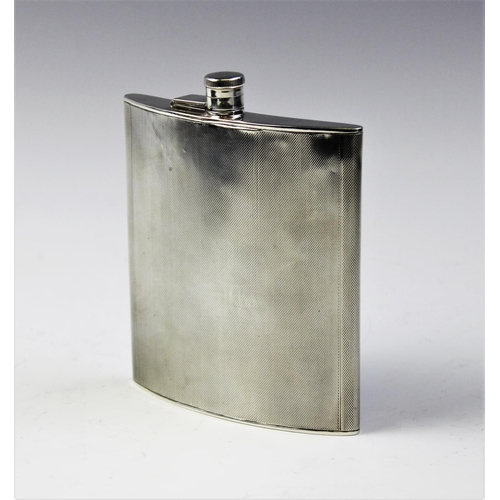 59 - A George V silver hip flask by A Wilcox, Birmingham 1936, of curved rectangular form with engine tur...