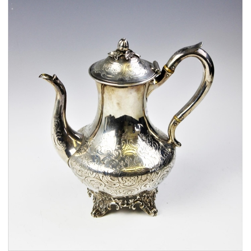 14 - A Victorian silver coffee pot by John Wellby, London 1843, of baluster form on four scrolling feet, ...