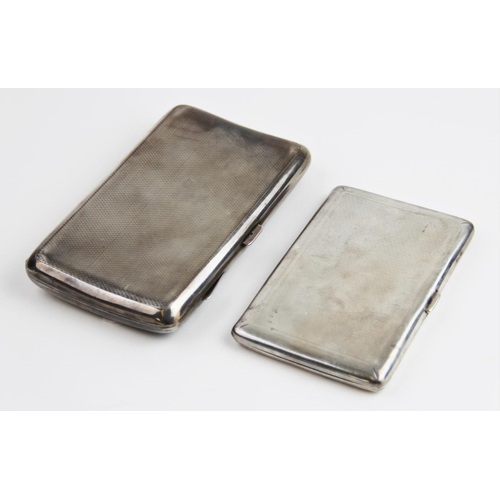 31 - A George V silver cigarette case by Cohen & Charles, London 1930, of rectangular form with engine tu...