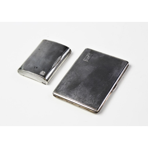37 - A George V silver cigarette case by E J Trevitt & Sons, Chester 1933, of rectangular form with engin...