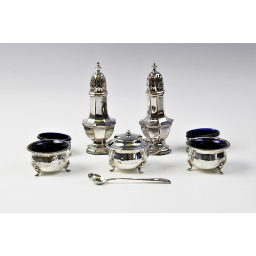 38 - A selection of silver tableware, to include a pair of table salts and matching wet mustard by T H Ha...