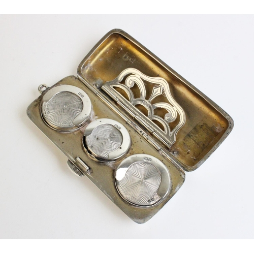 60 - A George V silver sovereign holder by Fenton, Russell & Co Ltd, Chester 1912, of rectangular form wi...