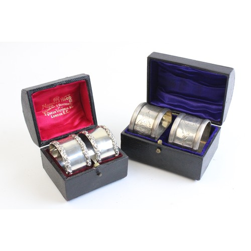 47 - A pair of Edwardian boxed silver napkin rings by Mappin & Webb, London 1908, of circular form with m...