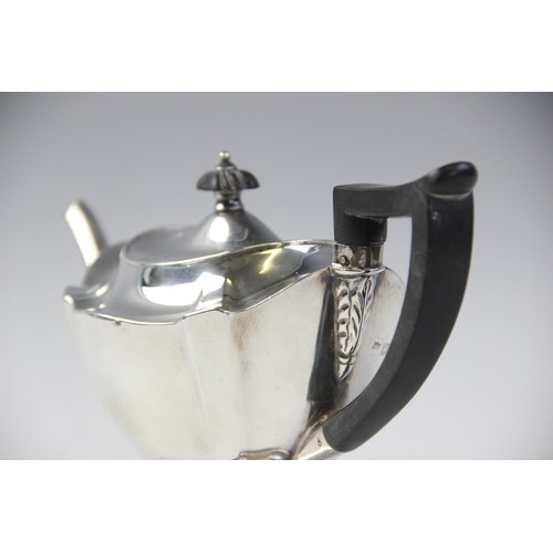 48 - An Edwardian silver teapot by Thomas Bradbury & Sons, London 1904, of shaped oval form on pedestal f...