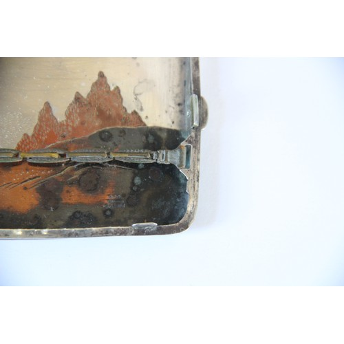 27 - A Japanese sterling silver and copper inlaid cigarette case, of rectangular form decorated with pago...
