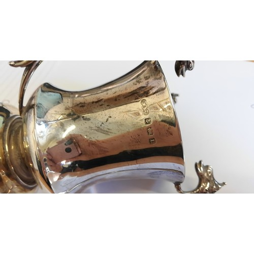 8 - A silver and silver gilt Arts & Crafts style trophy cup by Robinson & Co, Birmingham 1935, of taperi...