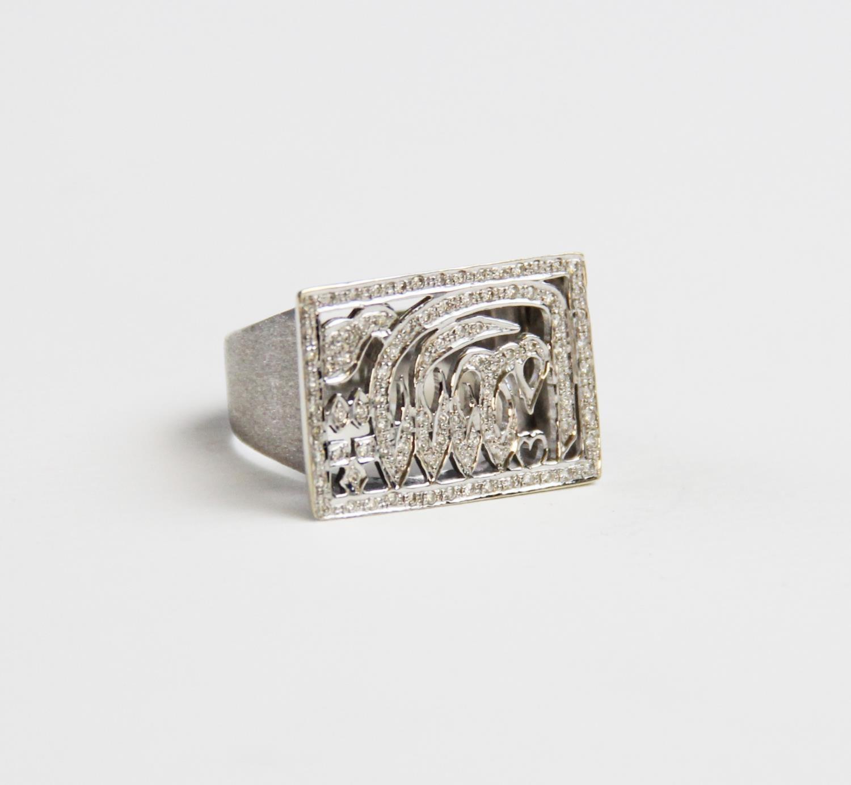 An 18ct diamond set signet ring, the cen...