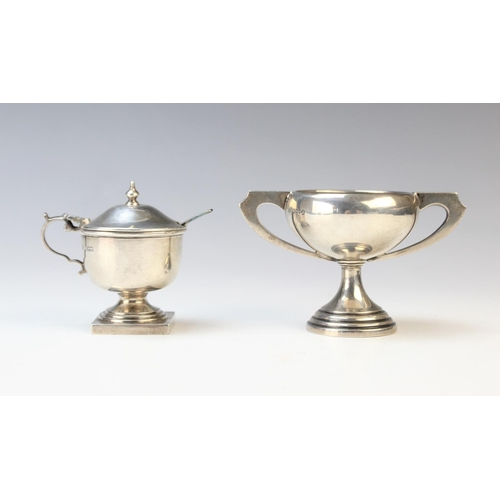 20 - An Art Deco miniature silver twin-handled trophy by Emile Viner, Sheffield 1934, of compressed form ...