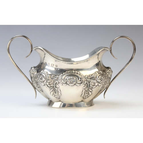 21 - An Edwardian twin-handled silver sugar bowl by Joseph Gloster, Birmingham 1901, of oval form with sh...