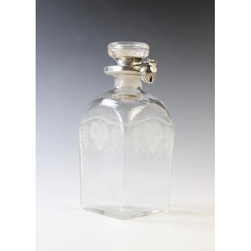 33 - A George V glass and silver locking decanter by Asprey & Co Ltd, Birmingham 1932, of square form dec...