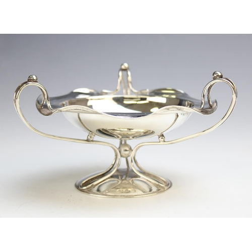 34 - An Art Nouveau silver tazza by Hukin & Heath, Birmingham 1906,of circular form with shaped rim with ...
