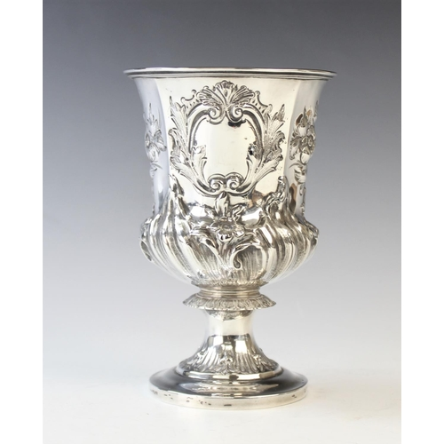 45 - A William IV silver chalice, London 1834, of pedestal form and later embossed with foliate decoratio...