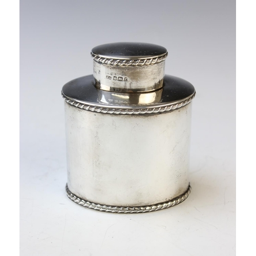 49 - A silver tea caddy and cover, Atkin Brothers, Sheffield 1897, of oval form and with rope twist borde...