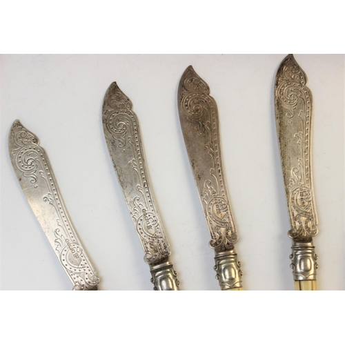 51 - A collection of Victorian silver bladed and ivory handled cutlery, Martin Hall and Co Sheffield circ...
