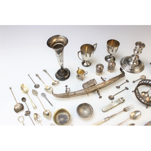 54 - A selection of silver and plated wares, to include; a silver candlestick, William Comyns and Sons, L...