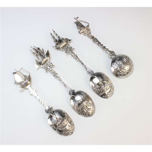 59 - Three Dutch silver spoons, each designed with pictorial bowl depicting harbour, lock and light house...