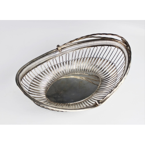 3 - A George III silver bread basket by Samuel Roberts, George Cadman & Co, Sheffield 1796, the navette ...