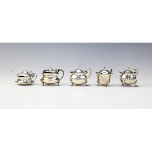 16 - A selection of silver mustard pots and salts to include; a pair of open salts by James Swann, Birmin...