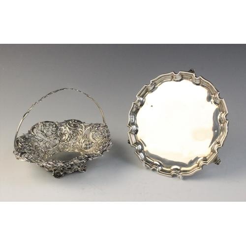 10 - An Edwardian silver swing handled basket by Henry Matthews, Birmingham (date letter worn), of shaped...