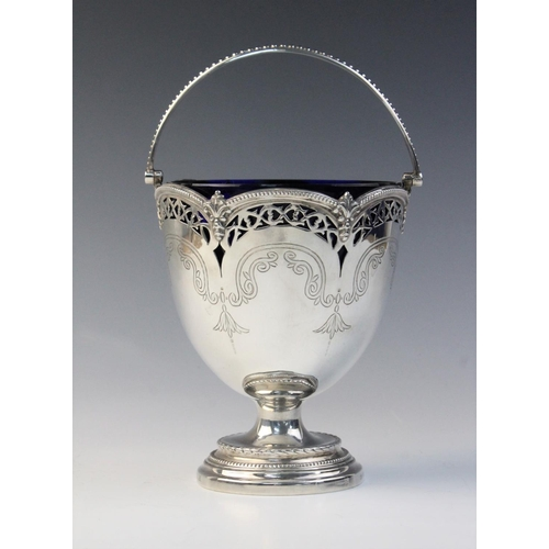 17 - A Victorian silver swing-handled sugar basket by Henry Wilkinson & Co, London 1872, the tapering bow...