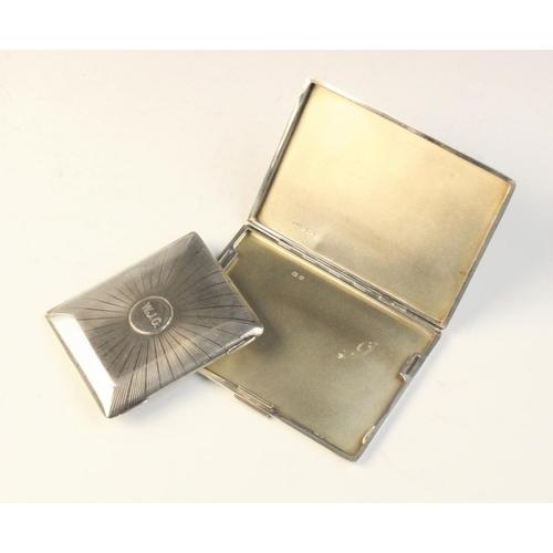 20 - An Art Deco silver cigarette case by W H Manton Ltd, Birmingham 1933, of rectangular form with engin...