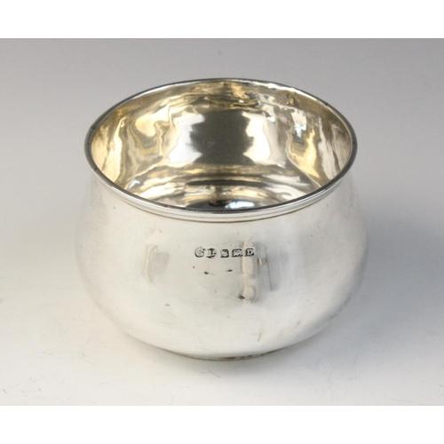 21 - A silver wine taster, Birmingham 1958 (maker's marks worn), of circular form with scrolling handles,...