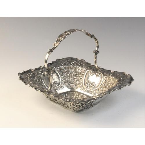 25 - An Edwardian silver swing-handled sweetmeat basket by Martin, Hall & Co, Sheffield 1903, of rectangu...
