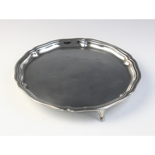 26 - A George V silver salver by William Hutton & Sons, Sheffield 1925, of circular form with shaped reed...