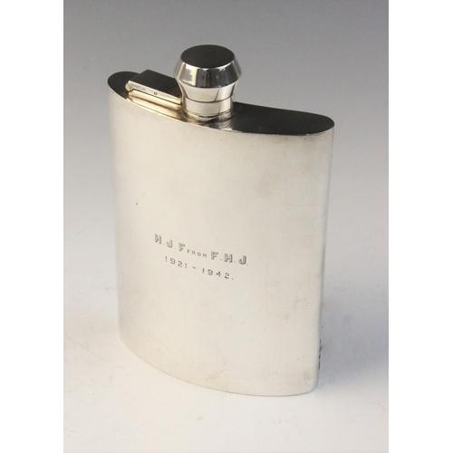 29 - A George V silver hip flask by F Burton Crosbee, Birmingham 1942, of curved rectangular form with ba...
