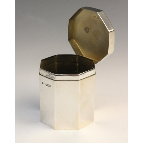 3 - A George V silver tea caddy by Walker & Hall, Sheffield 1922, of octagonal form with hinged cover an...