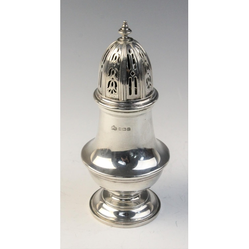 30 - A George V silver sugar caster by Elkington & Co, Birmingham 1928, of  baluster form with reeded bor...