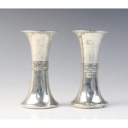 31 - A pair of silver posy vases Gorham Manufacturing Co, Birmingham 1910-11, each of flared form decorat...