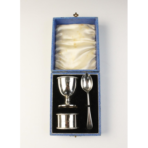 38 - A boxed silver Christening set by Adie Brothers, Birmingham 1938, comprising egg cup, spoon and napk...
