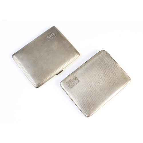 40 - A silver cigarette case by H Pidduck & Sons, Birmingham 1958, of rectangular form with engine turned...