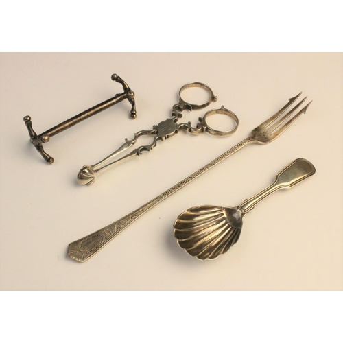 44 - An assortment of silver cutlery, to include; a pair of George III silver sugar tongs, with shell for...