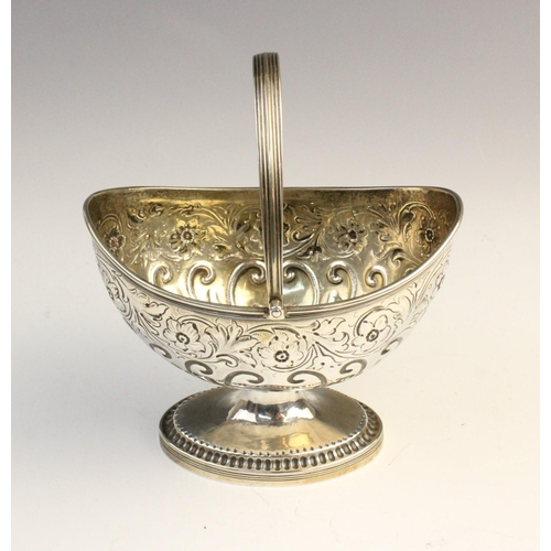46 - A George III silver swing-handled sweetmeat basket by Crispin Fuller, London 1794, of oval form on p...