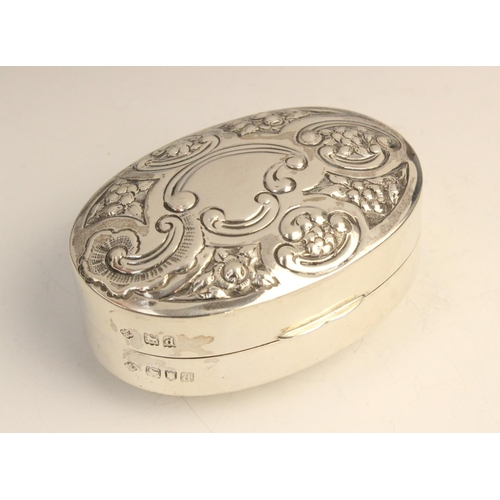 49 - A Victorian silver pill box by William Hutton & Sons, London 1899, of convex oval form, the hinged c...