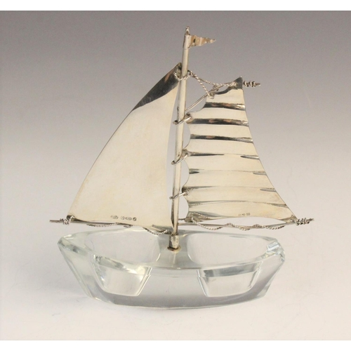 58 - A novelty silver and glass salt in the form of a sailing boat, import marks for Israel Freeman & Son...